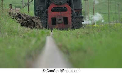 Vintage Steam Locomotive Approaching - Rail low angle view...