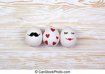Funny eggs with painted faces