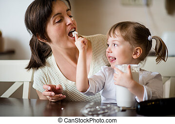 Licking of whipping cream - mother with daughter - Mother...