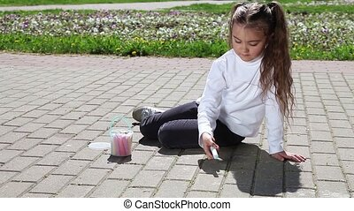 Little girl with colorful chalks - Little Caucasian girl...
