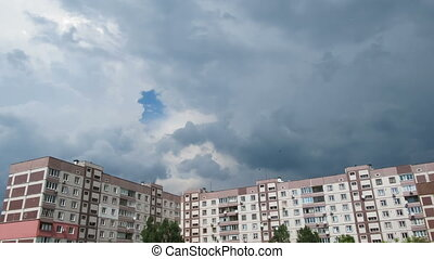 Storm Clouds Moving over the Multistorey Buildings Time...