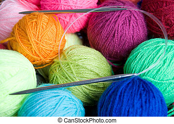wool knitting - colorful balls of wool and knitting needle