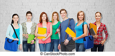 group of teenage students with folders and bags - education,...