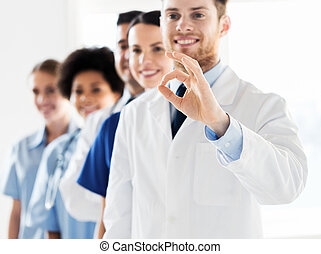 close up of doctors showing ok sign at hospital - gesture,...