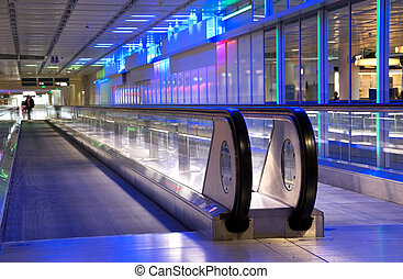 airport walkway - person on moving sidewalk in an airport