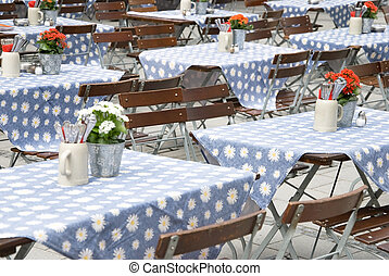 beer garden munich - tables in a typical beer garden in...
