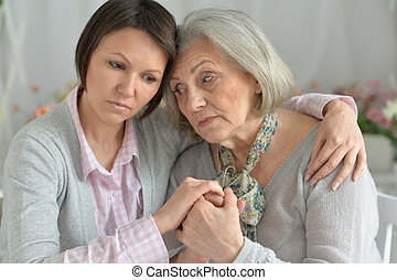 miserable mother and adult daughter