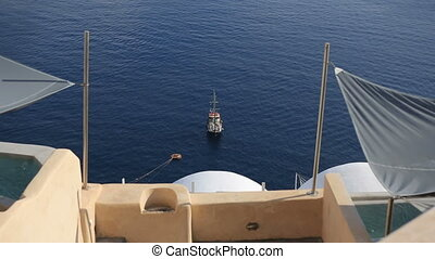 Cruise ship on the anchor near greek island Santorini.