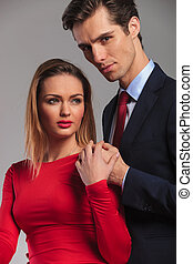 young business man holding hand on his wife's shoulder
