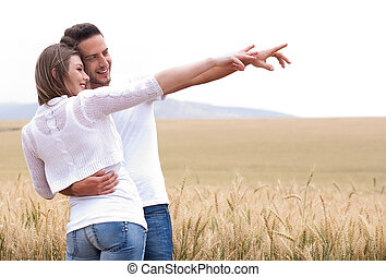 Young couple in meadow