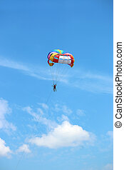 parasailing on blue sky summer season