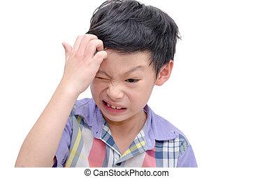 Young boy scratching his scalp - Young Asian boy scratching...