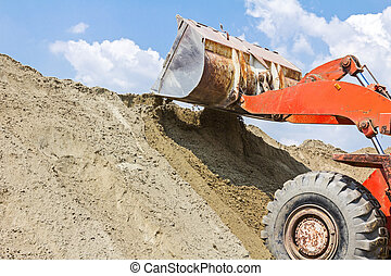 Bulldozer, view on front end loader - Red loader with wheels...