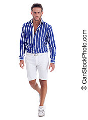 Young guy in  casual wear ready to walk
