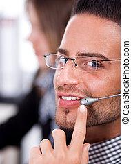business man speaking through head phone