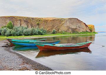 fishing boats at river bank Volga in Russia