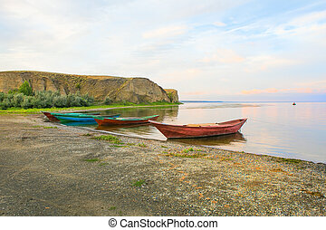 fishing boats at river bank Volga in Russia
