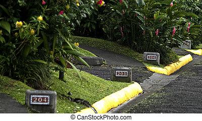 Street curb - Numbers at the road curb marking the house...