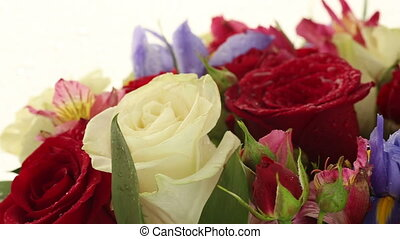 Beautiful bouquet roses, iris and alstroemeria rotates. -...