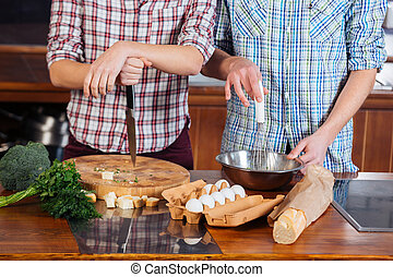Young couple cooking together on the kitchen - couple...