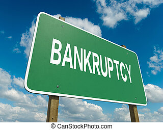 bankruptcy - A road sign with bankruptcy words on sky...