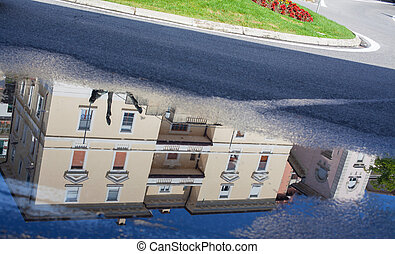 Reflection in a puddle - Reflection in a puddle on the...