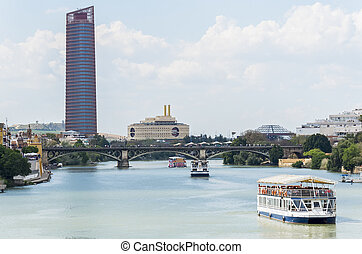 Guadalquivir river, Seville Tower, Triana bridge, Seville,...