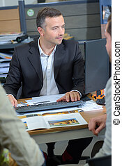 Salesman in meeting with couple