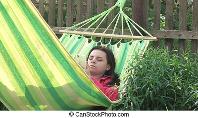 Girl asleep in hammock - Nature in hammock and smiling girl...