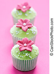 Cupcakes - Three green and pink cupcakes against pink