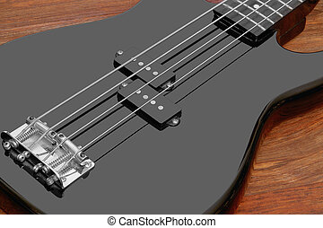 black bass guitar detail - detail of a black bass guitar in...
