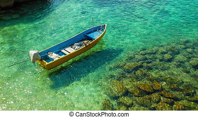 Boat on clear sea - Fishing boat on clear turquoise sea