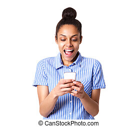 Young woman laughing with mobile phone - Portrait of young...