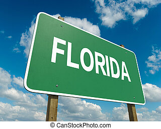 florida - A road sign with florida words on sky background