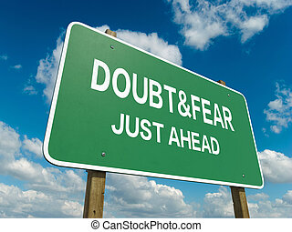 doubt fear - A road sign with doubt fear words on sky...