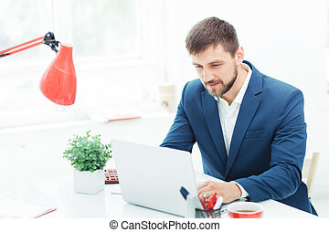 The elegant businessman sitting in the office - Elegant...