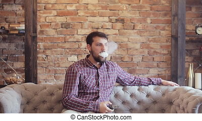 Handsome man smoking electric e cigarette vapor - Man...