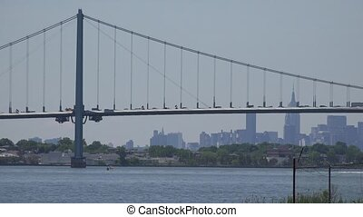 Suspension Bridge and City Skyline
