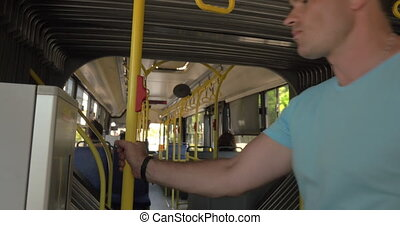 Man using bus ticket machine - Young man using touchscreen...