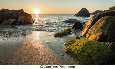 Sea sunset on the rocky shore