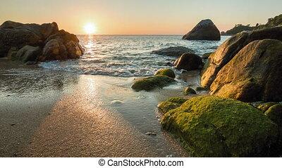 Sea sunset on the rocky shore - Sea sunset on sand shore...