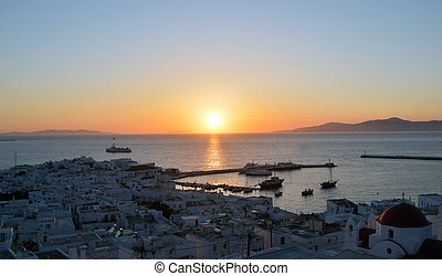 View of Mykonos town at beautiful sunset, Greece