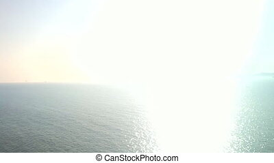 Dazzling sunrise. Sun rises over sea. - Concept of natural...