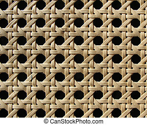 Bright decorative wicker grille screen. Background. Macro