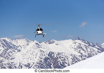 White rescue helicopter in the mountains - White rescue...
