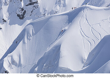Snowboard freeride, snowboarders and tracks on a mountain...