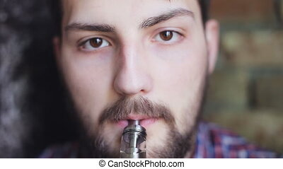 handsome man Exhaling smoke from a vaporizer shot - Man...