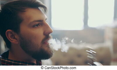 young stylish man with electronic cigarette vaping - Man...