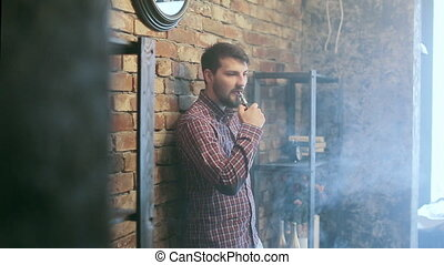 Man Exhaling smoking electronic cigarette - Man Exhaling...