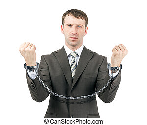 Business man wearing suit in handcuffs isolated on white